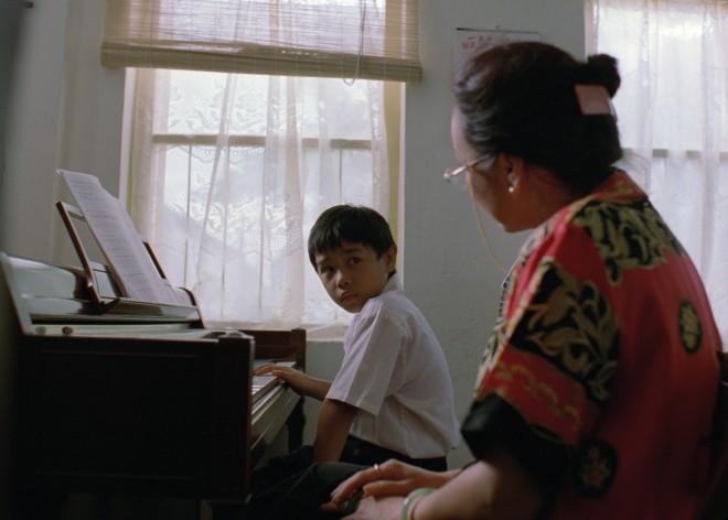 Piano-teacher-and-boy